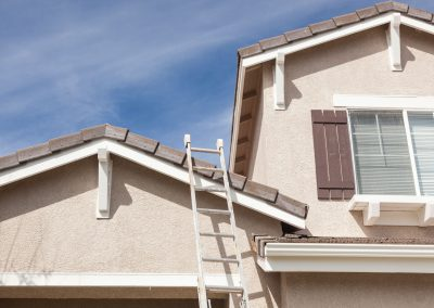 Ladder-Leaning-Against-Painted-Stucco